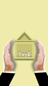 Hands holding a house image