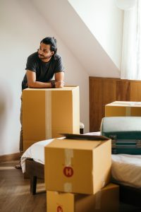 Man Packing and Moving To New Home